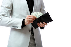 Confident businessman giving US dollars at you Royalty Free Stock Photos