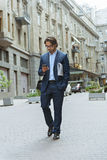 Confident businessman going to work royalty free stock photo