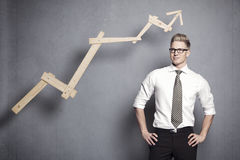 Confident businessman with graph. Stock Photos