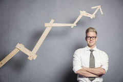 Confident businessman with graph. Royalty Free Stock Photography