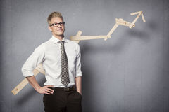 Confident businessman with graph. Royalty Free Stock Photos