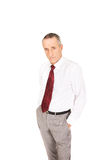 Confident businessman with hands in pockets Stock Photos
