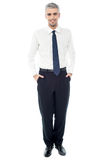 Confident businessman with hands in pockets Royalty Free Stock Photography