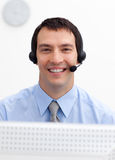 Confident businessman with headset on Royalty Free Stock Photos