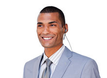 Confident businessman with headset on against Stock Images