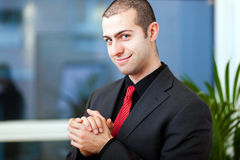 Confident businessman in his office royalty free stock photography