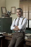Confident businessman in his office Stock Photos