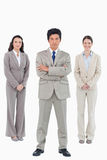 Confident businessman with his team behind him Royalty Free Stock Images
