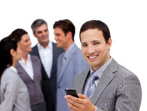Confident businessman and his team standing Stock Photography