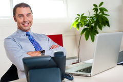 Confident businessman at his workstation Stock Photos