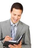 Confident businessman holding an agenda Stock Photos