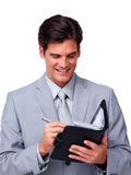 Confident businessman holding an agenda Royalty Free Stock Images