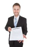 Confident businessman holding contract paper Royalty Free Stock Image
