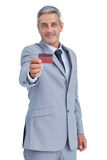 Confident businessman holding credit card Royalty Free Stock Photography