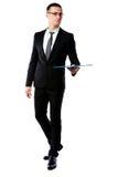 Confident businessman holding folder Royalty Free Stock Photos