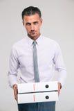 Confident businessman holding folders Stock Photography