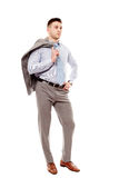 Confident businessman holding his coat with hand on hip Royalty Free Stock Image