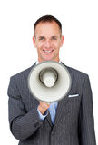 Confident businessman holding a megaphone. Isolated on a white background Stock Photography