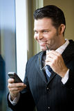 Confident businessman holding mobile phone Stock Photo