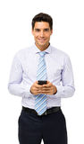 Confident Businessman Holding Smart Phone Stock Photos