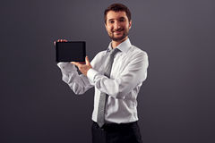 Confident businessman holding the tablet pc Royalty Free Stock Images