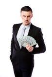 Confident businessman holding US dollars Stock Photo