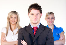 Confident businessman infront of the women Royalty Free Stock Photos
