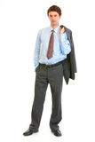 Confident businessman with jacket on his shoulder Stock Photography