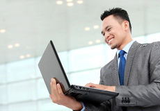Confident businessman with laptop Royalty Free Stock Photo
