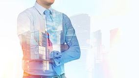 Confident businessman and large morning city Stock Image