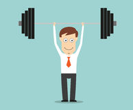 Confident businessman lifting a heavy barbell Stock Photos