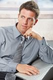 Confident businessman looking aside Stock Photos