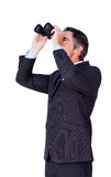 Confident businessman looking through binoculars Stock Image