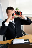 Confident businessman looking through binoculars Royalty Free Stock Photos