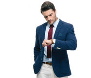 Confident businessman looking on his wrist watch Stock Photography
