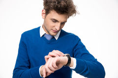 Confident businessman looking at watch Stock Images