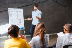 Confident businessman making presentation using whiteboard in office Royalty Free Stock Image