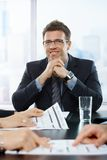Confident businessman at meeting Royalty Free Stock Photo
