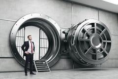 Confident businessman near open vault door Stock Images