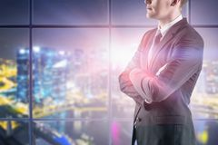 Confident businessman in night office royalty free stock photos