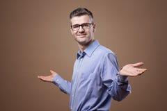 Confident businessman palms up Stock Photo