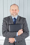 Confident businessman. Picture of a confident businessman posing at his office Stock Photography