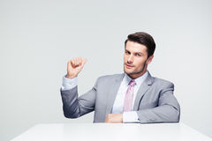 Confident businessman pointing finger back Stock Photos