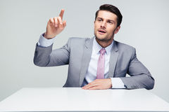 Confident businessman pointing finger up Stock Image