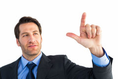 Confident businessman pointing at something Stock Photos