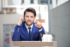 Confident businessman pointing straight Stock Photography