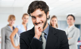 Confident businessman portrait with his team Royalty Free Stock Images