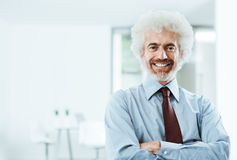 Confident businessman posing in the office Stock Photography