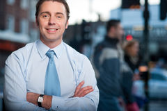 Confident businessman posing, street background Stock Images