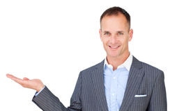 Confident businessman presenting Royalty Free Stock Photos